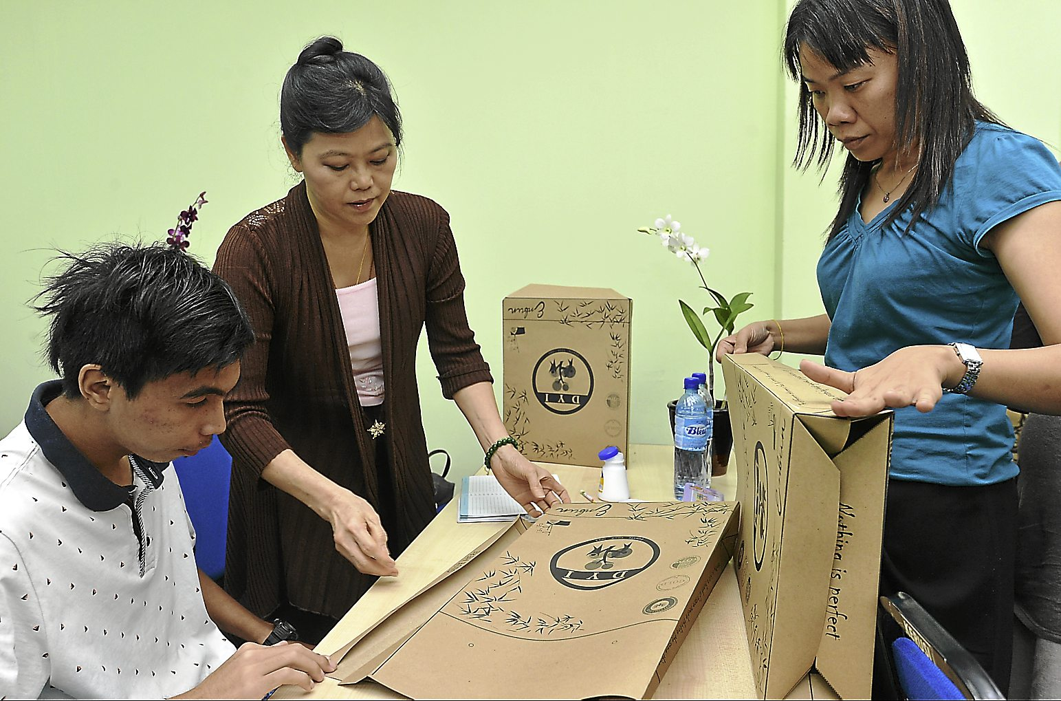 Some of the participants getting their hands on in creating a paper bag during the Donate Your Idea Workshop at  Skills Technical Innovation College, Kuala Lumpur on July 8.