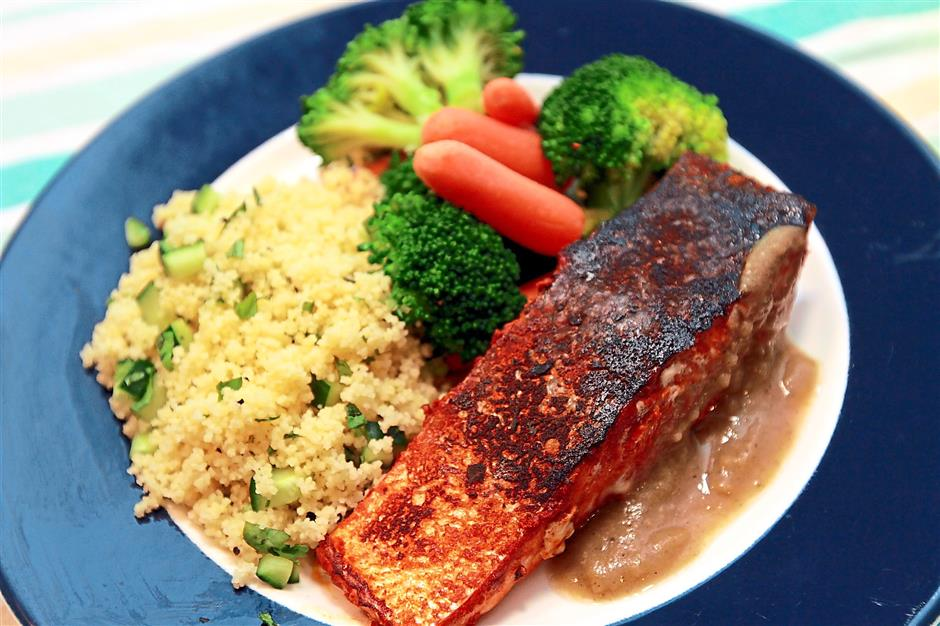 A wholesome meal of salmon, couscous and broccoli from The Lean Canteen.