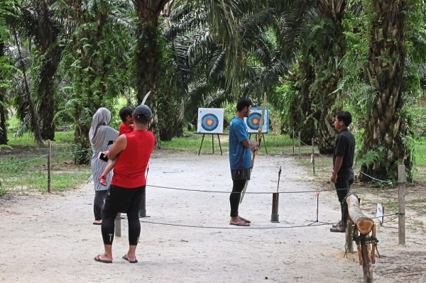 Guests trying their hand at archery.