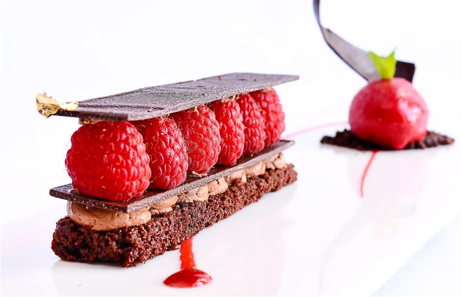 Flavourful harmony: The classic pairing of tart berries and rich chocolate is elevated many notches with the popular Raspberry Mille Feuille.