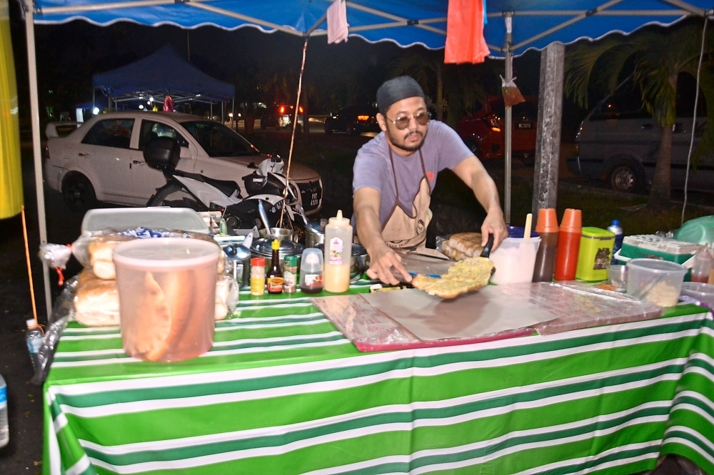 Mohd Zaki and his brother have gone into the business of selling roti John full-time.