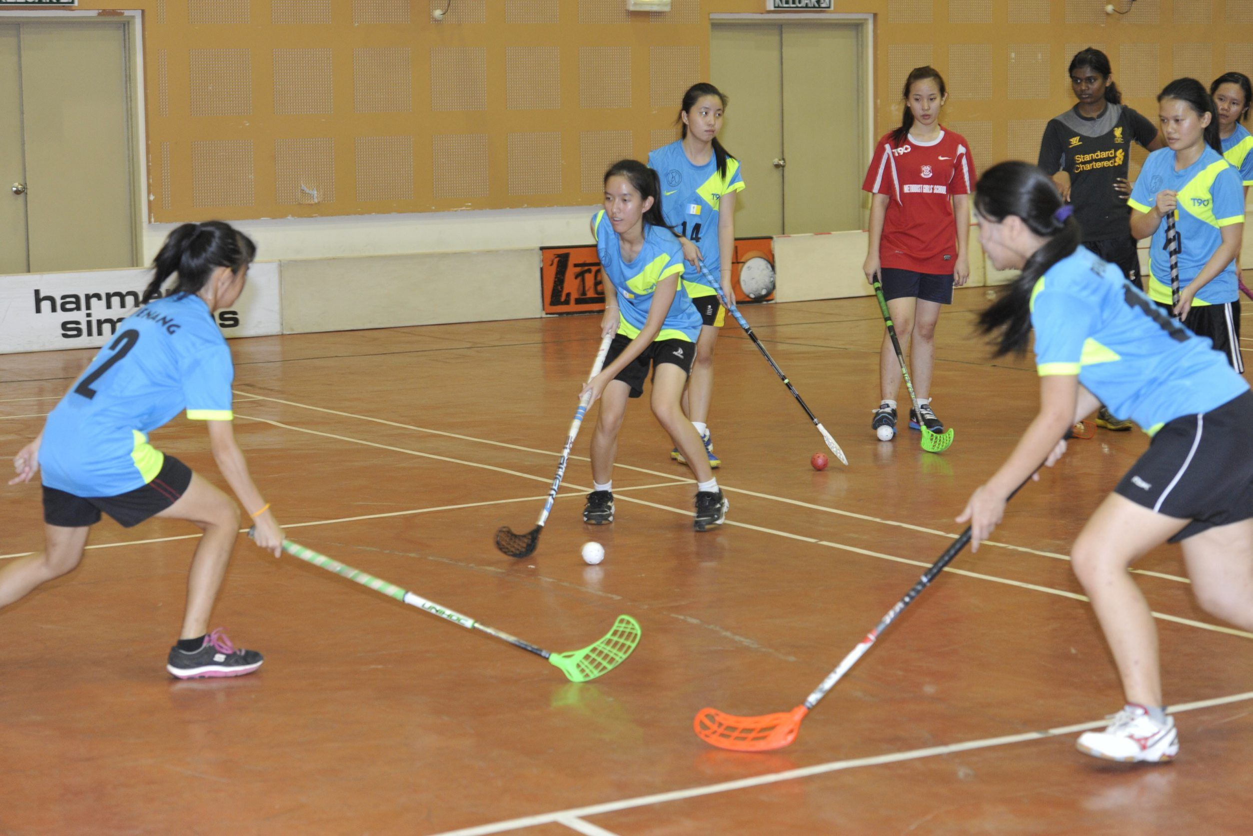 Floorball is a bit like indoor hockey, albeit safer and using rink boards.