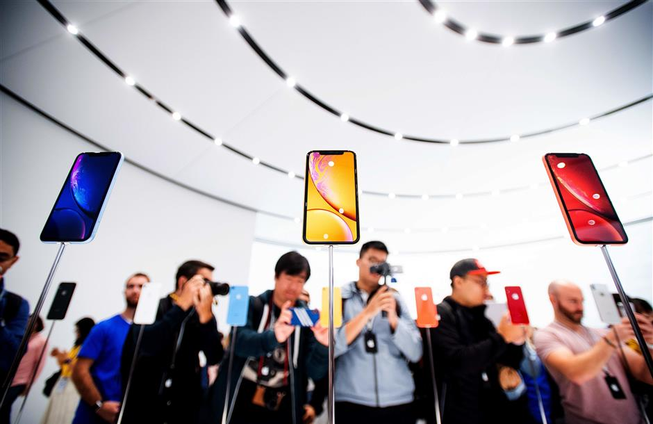 (FILES) In this file photo taken on September 12, 2018 Apple iPhone Xr models rest on display during a launch event in Cupertino, California. - What is next for the smartphone, which has become the hottest-selling consumer device around the world in just over a decade? Even as top makers like Apple and Samsung unveil new handsets with new features and improved performance, smartphone sales have flattened with most major markets largely saturated. (Photo by NOAH BERGER / AFP)