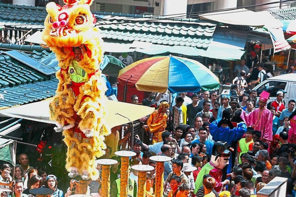 A lion dance performance in Petaling Street. — filepic