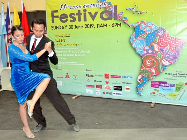 Dancers Fernanda Cajide and Christopher Gan giving a preview of the fun they can look forward to at the launch of the festival.