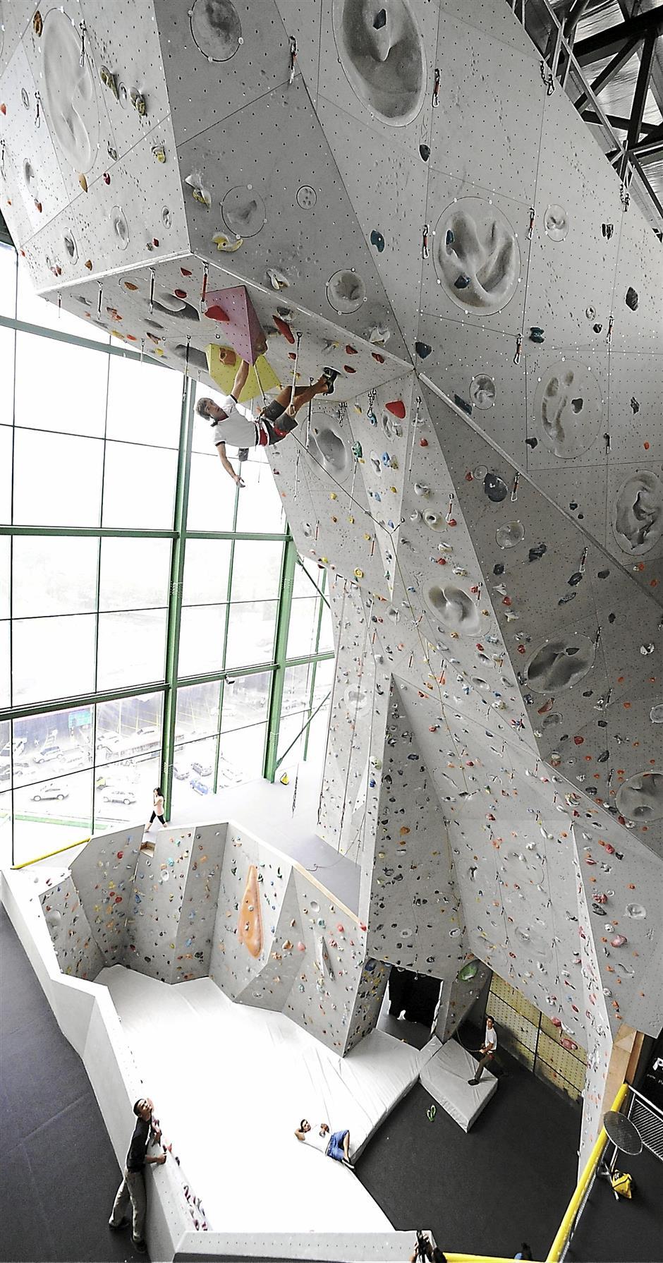 Chris Sharma tackling some super- tough sections of the climbing wall at Camp5.