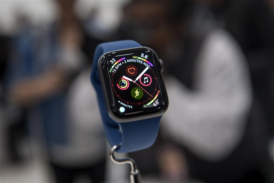 An Apple Watch series 4 is displayed during an Apple Inc. event at the Steve Jobs Theater in Cupertino, California, U.S., on Wednesday, Sept. 12, 2018. Apple Inc.u00a0took the wraps off a renewed iPhone strategy on Wednesday, debuting a trio of phones that aim to spread the company\'s latest technology to a broader audience. Photographer: David Paul Morris/Bloomberg