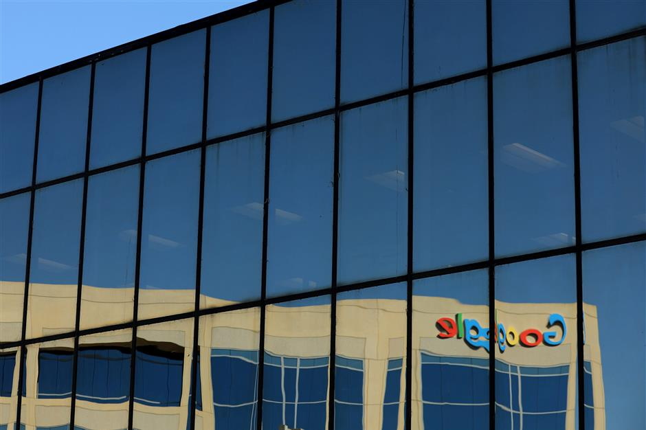 FILE PHOTO: The Google logo is shown reflected on an adjacent office building in Irvine, California, U.S. August 7, 2017.   REUTERS/Mike Blake/File Photo