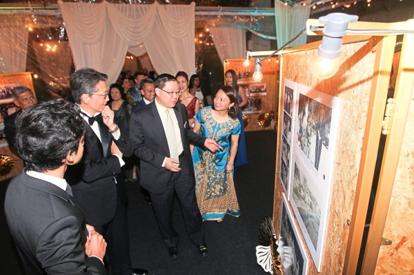 (From right) Yeoh, Lim, Loy and Sanjay looking at old pictures of the university at the dinner.  u2014 MUHAMAD SHAHRIL ROSLI/The Star.