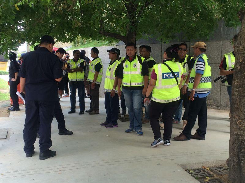 Police officers gathering outside Dataran Maybank.