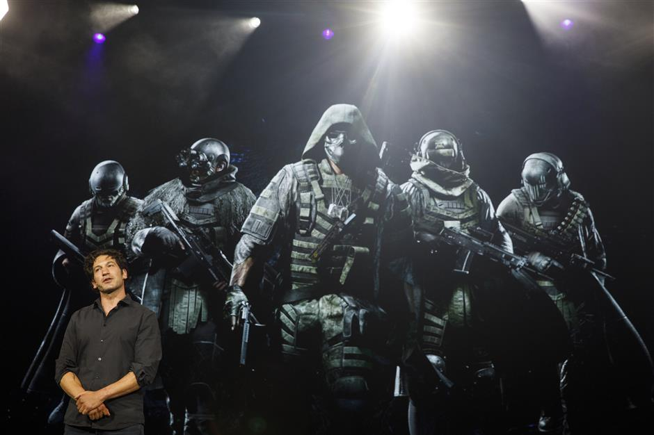 Actor Jon Bernthal speaks about Tom Clancy\'s Ghost Recon Breakpoint video game during a Ubisoft Entertainment SA event ahead of the E3 Entertainment Expo in Los Angeles, California, U.S., on Monday, June 10, 2019. Ubisoft announced that Uplay+, its new subscription service, will launch on September 3, 2019, for Windows PC. Players will be able to download more than 100 games, including new releases. Photographer: Patrick T. Fallon/Bloomberg