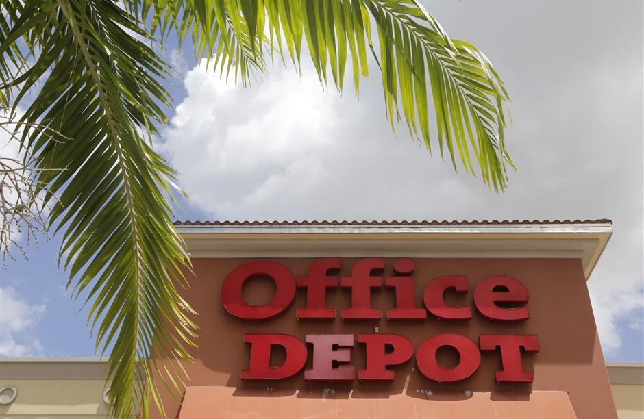 FILE- This April 11, 2017, file photo, shows Office Depot in Doral, Fla. Office Depot Inc. reports financial results Wednesday, Feb. 27, 2019. (AP Photo/Lynne Sladky)