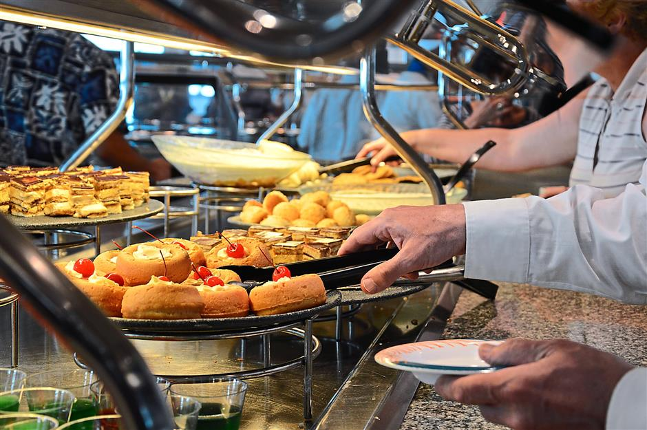 Guests helping themselves to the buffet onboard the Mariner of the Seas