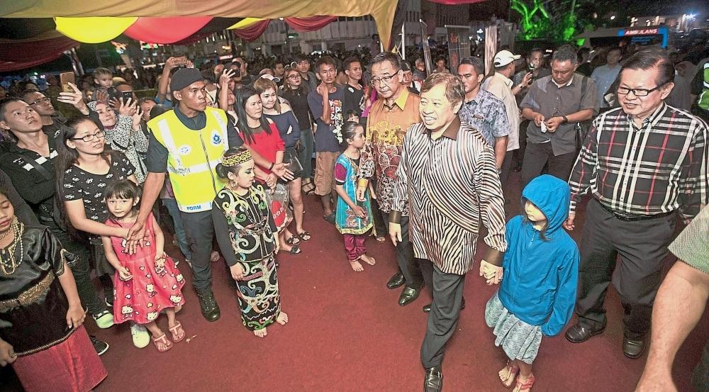 Abang Johari (in batik shirt) arriving at the Kuching Waterfront for the New Year countdown.