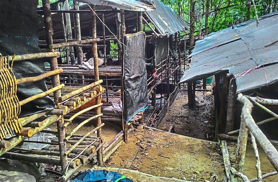 Scenes of despair: The camp sites discovered by the Royal Malaysian Police where migrants were housed and forced to survive in the grimmest of circumstance by people smugglers in a jungle near the Malaysia-Thailand border in Genting Perah. — AFP
