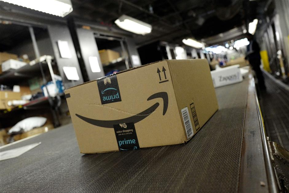 FILE- In this May 9, 2017, file photo, a package from Amazon Prime moves on a conveyor belt at a UPS facility in New York. Amazon\'s Prime Day starts July 16, 2018, and will be six hours longer than last year\'s and will launch new products. (AP Photo/Mark Lennihan, File)