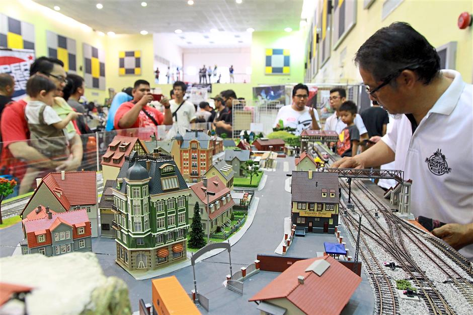 Tiny town: A miniature town with moving trains and buses attracted a lot of admirers at the festival.