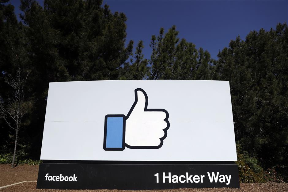 FILE - This March 28, 2018, file photo shows a Facebook logo at the company\'s headquarters in Menlo Park, Calif. Facebooku2019s plan to create a digital currency used across the world is already raising concern with financial regulators and privacy experts. (AP Photo/Marcio Jose Sanchez, File)