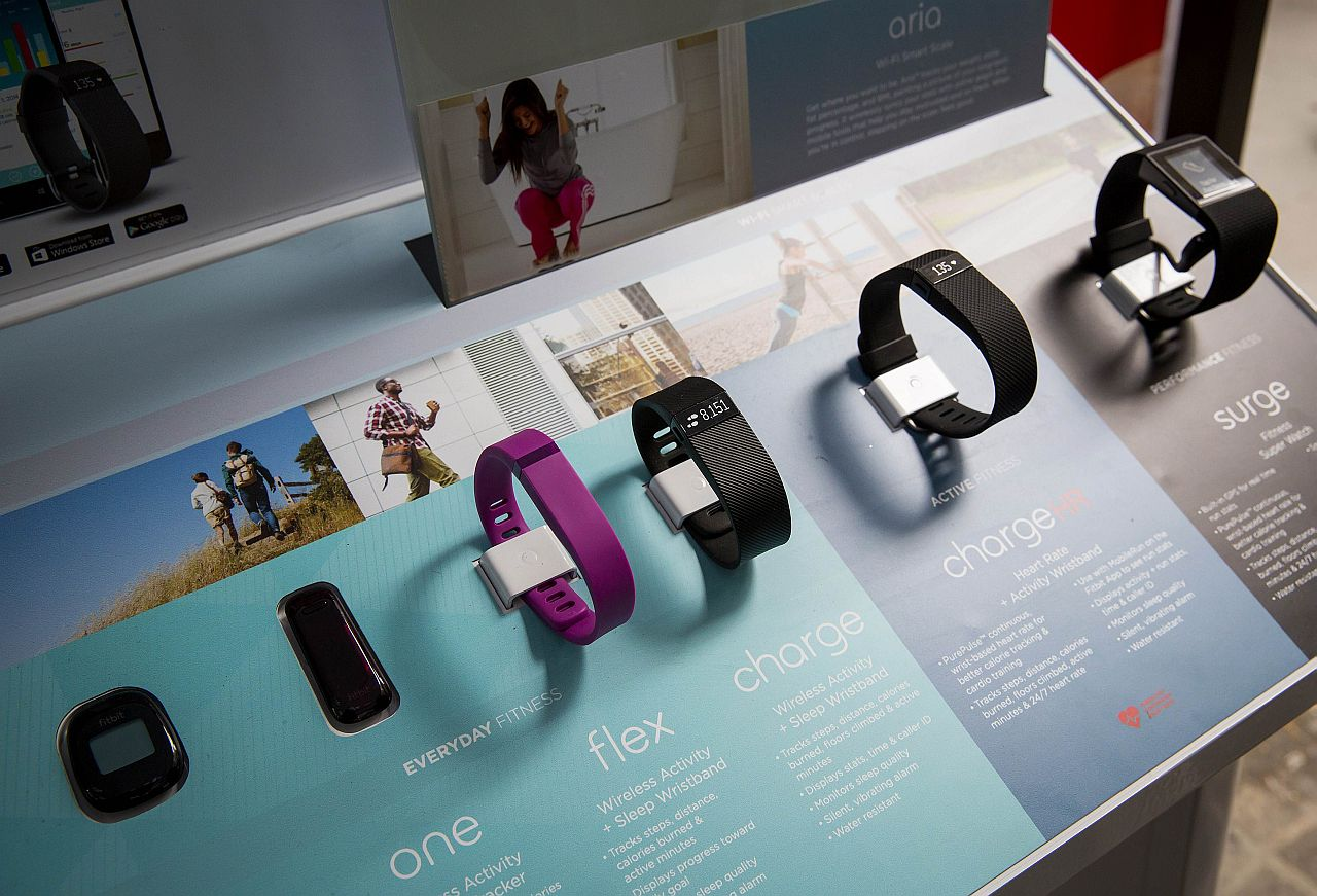 NEW YORK, NY - JUNE 18: The line of Fitbit products are displayed during a lunchtime workout event outside the New York Stock Exchange during the IPO debut of the company on June 18, 2015 in New York City. According to reports, shares of Fitbit, which makes wearable fitness tracking devices, rose significantly on Thursday after debuting as a public company on the New York Stock Exchange.   Eric Thayer/Getty Images/AFP == FOR NEWSPAPERS, INTERNET, TELCOS & TELEVISION USE ONLY ==