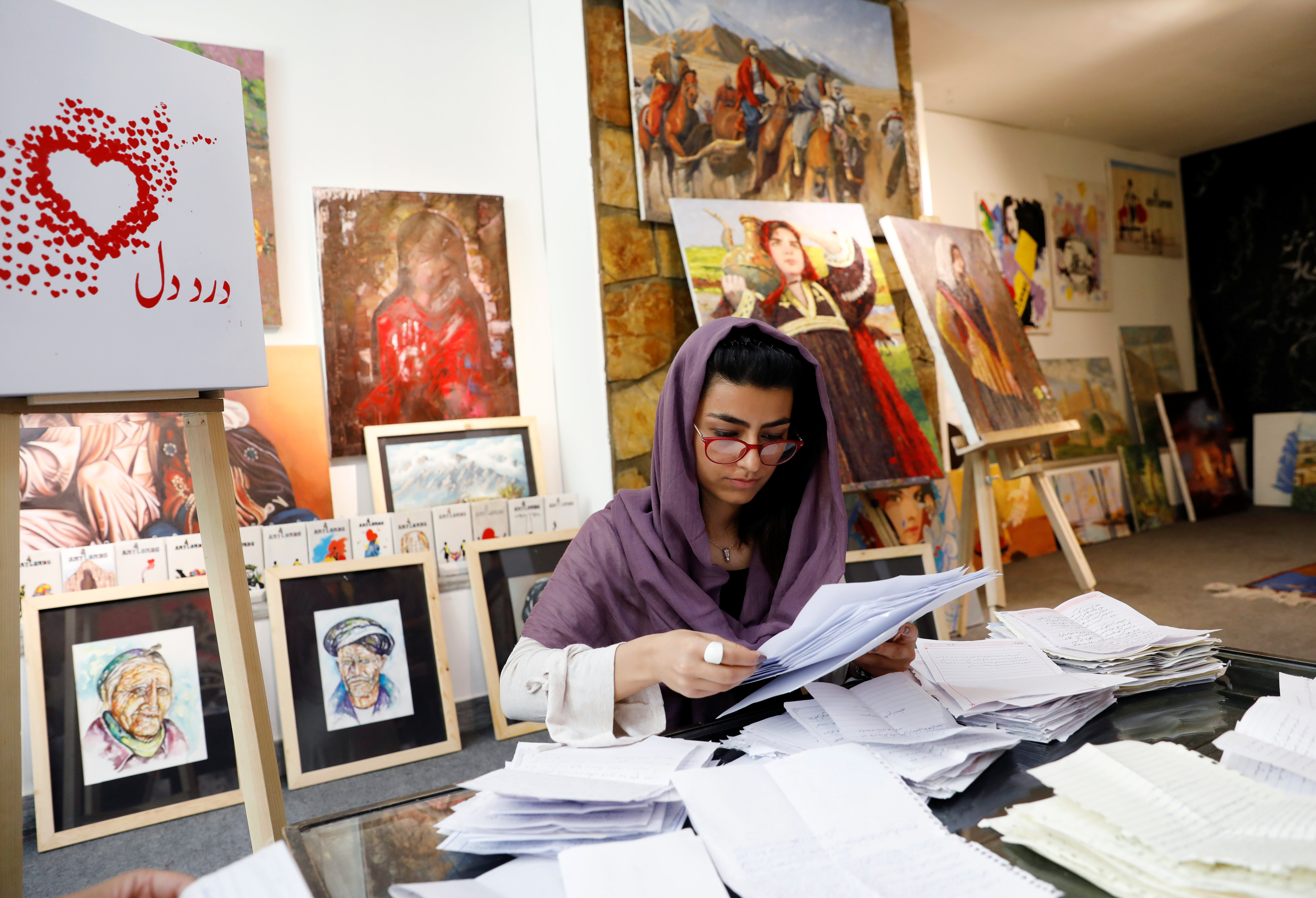A member of the ArtLords sorts letters of Dard-e-Dil (a painful heart) project in Kabul, Afghanistan July 6, 2019. Picture taken July 6, 2019. REUTERS/Mohammad Ismail
