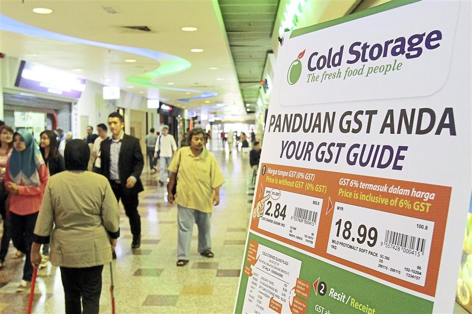 Educating shoppers: Many retailers have been putting ups signs to inform their customers of how GST would affect them