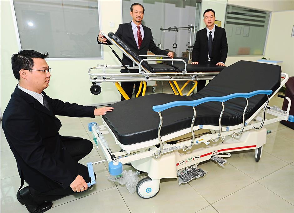 For patients: Ng (centre) showing some of the patient beds and stretcher trolleys under the company's growing medical-devices business segment.