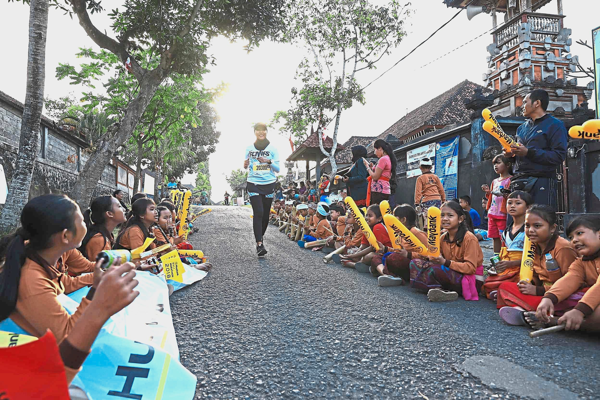 Children lining the route cheering therunners on as they passed through a village.