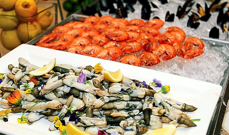 Cold seafood on ice - including bamboo clams (foreground), prawns (middle), New Zealand mussels (background) and oysters, are just one of the many buffet options.