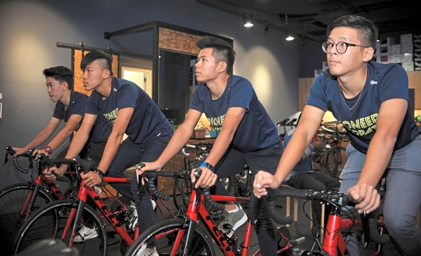 Going places: Riders of the CycologySabah Racing team (from left) Waldron Chee, Darren Chong, Bong Yong Xian and Lim Chun Kiat. u2014 AFIQUE YUSOFF / The Star