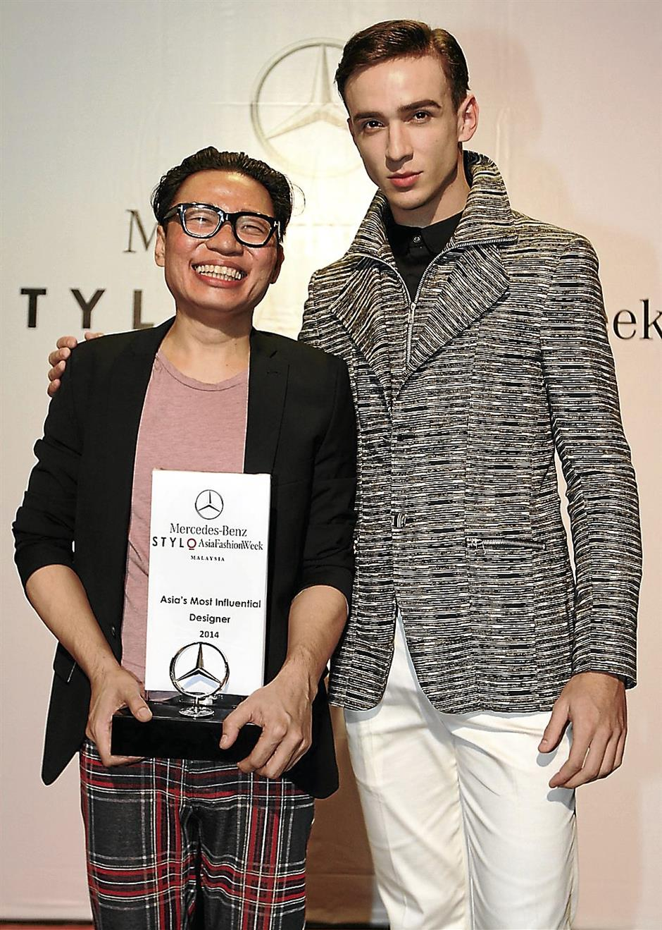 Avel Bacudio, named 'Asia's Most Influential Designer of 2014', with a model wearing his designs.