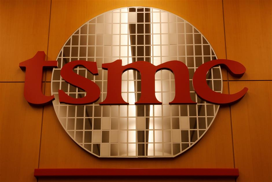 A logo of Taiwan Semiconductor Manufacturing Co (TSMC) is seen at its headquarters in Hsinchu, Taiwan August 31, 2018. Picture taken August 31, 2018. REUTERS/Tyrone Siu