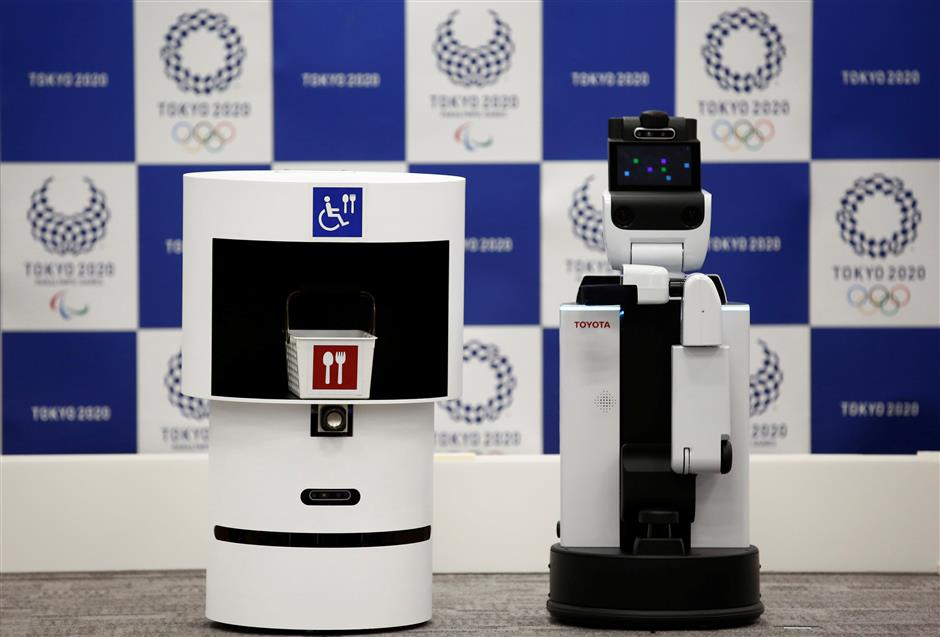 Toyota\'s DSR (Delivery Support Robot) (L) and HSR (Human Support Robot) are pictured at a demonstration of Tokyo 2020 Robot Project for Tokyo 2020 Olympic Games in Tokyo, Japan, March 15, 2019. REUTERS/Kim Kyung-hoon
