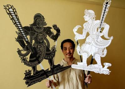 Thinking out of the box: Tintoy Chuo and the two wayang kulit puppets he and TakeHuat made: Maharaja Dah Vedeh (left) and Perantau Langit.