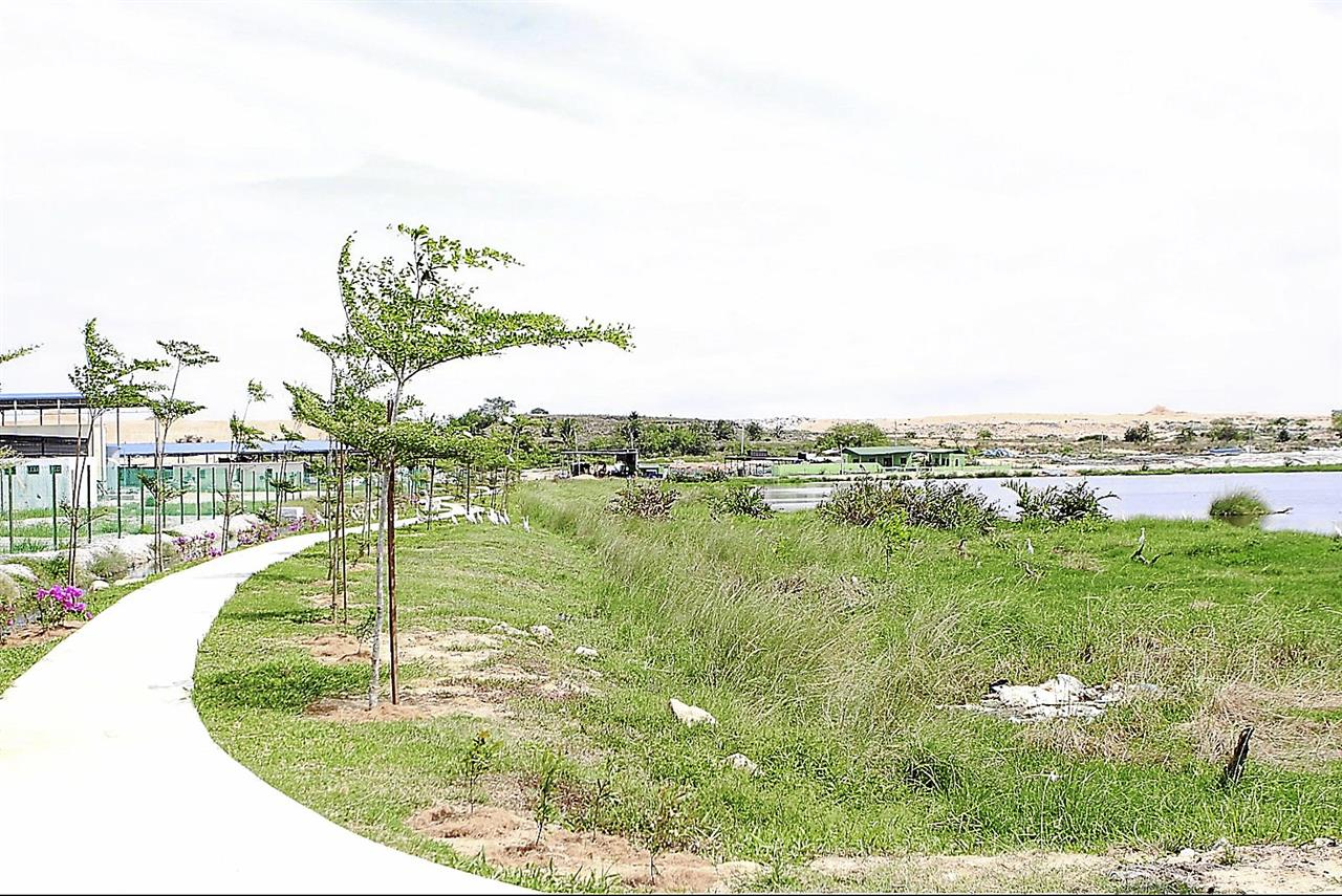 The fenced-up wetlands area that has been turned into a recreation park in Ladang Byram, Pulau Burung in Nibong Tebal, South Seberang Prai, Penang yesterday. MUHAMAD SHAHRIL ROSLI/The Star. JULY 29, 2013.
