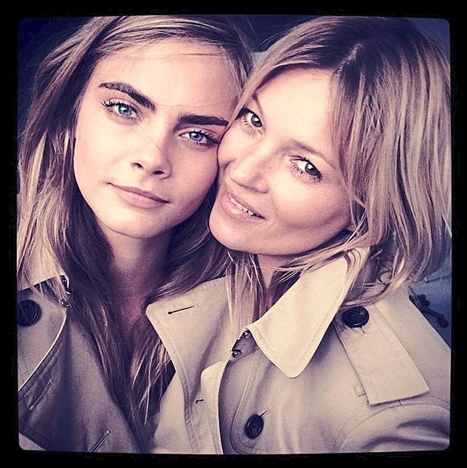Cara Delevingne and Kate Moss in Burgerry Heritage trench coats for the new Burberry fragrance campaign.
