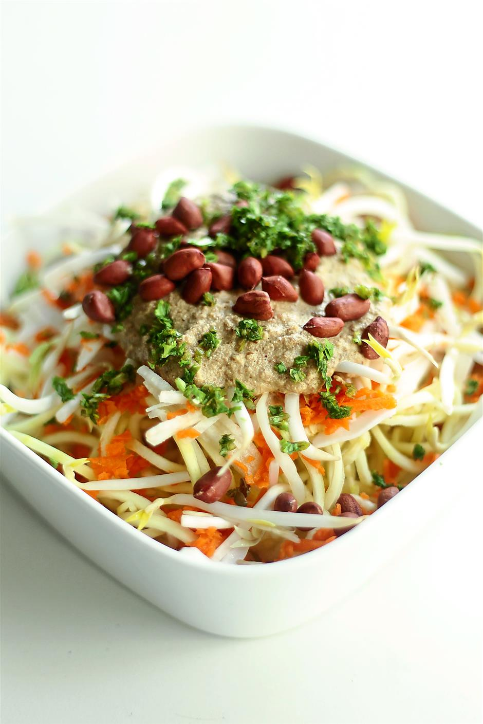 The raw pad thai prepared by Elke Wollschon of Delicious Detox Delivery uses only raw ingredients such as shredded sengkuang, carrots and nuts.