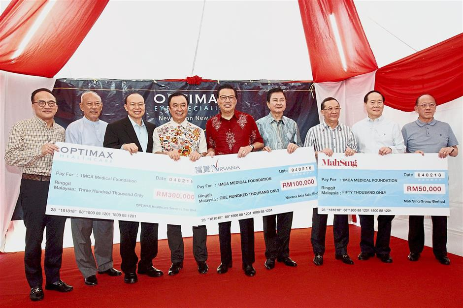 Caring hearts: (From left) Lee, Mohamad Noor, Dr Lim, Tan, Liow, Kong, Leong, Tang and Gan.