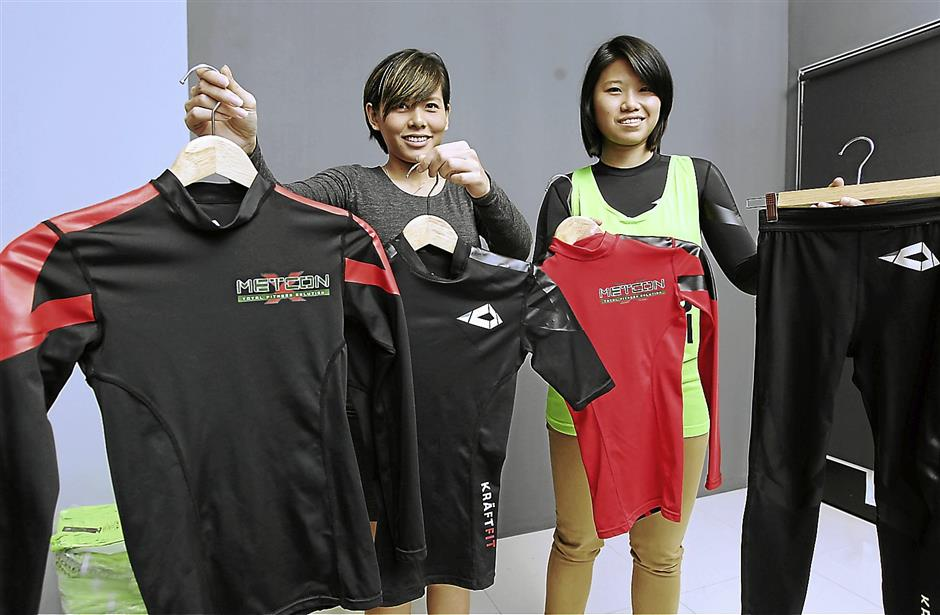 Tight: Kraftfit Malaysia, hopes to capture the fitness apparel market with its products and services. Cheng (left) and Leong are two out of four owners of the business.
