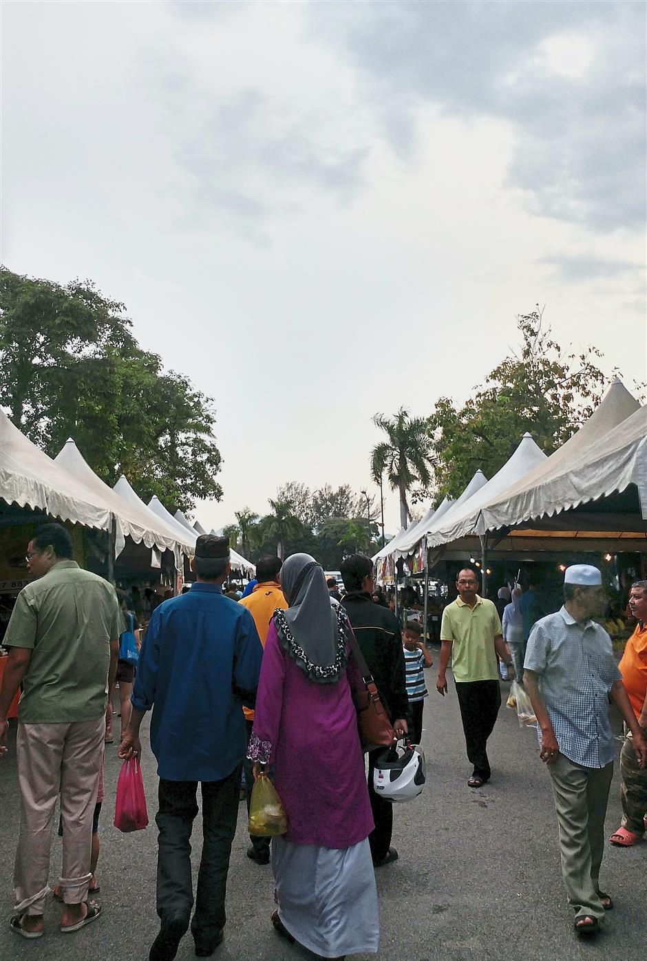 Gloomy clouds hovering over the Ramadan bazaar near the Perak Stadium.