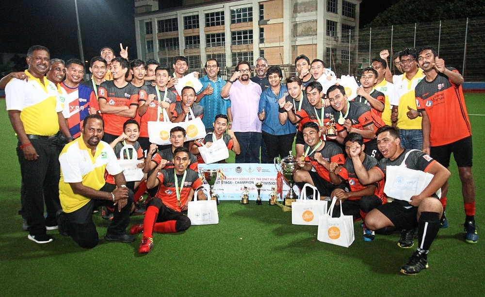 Double champions UPM celebrate with guests and committee members of the Selangor Hockey Association after clinching the double at the MBPJ Hockey Stadium in Petaling Jaya. u2014 MUHAMAD SHAHRIL ROSLI/The Star
