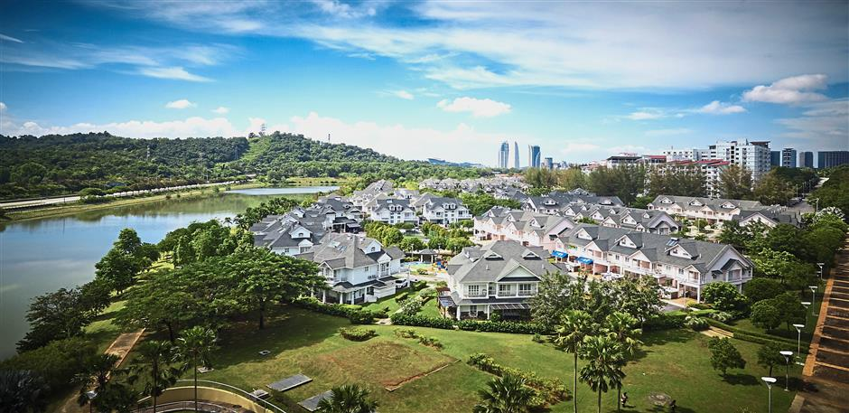 The residential areas in Putrajaya adopt a nofence policy to instil a sense of community. Seen here is New Haven.