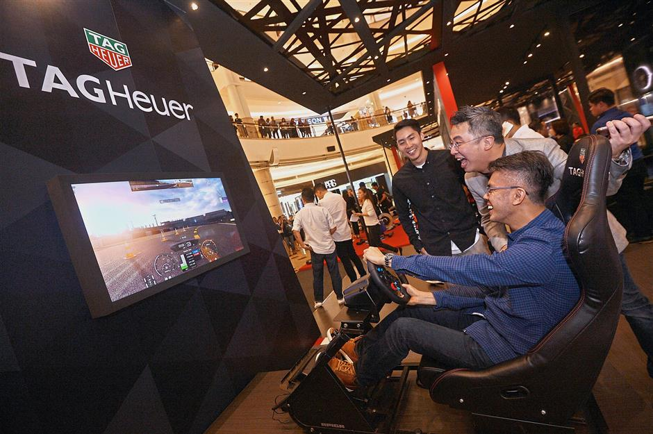 Guests can experience the world of Gran Turismo Sport through a simulator of the famous motorsport game at the TAG Heuer Sports Hub.