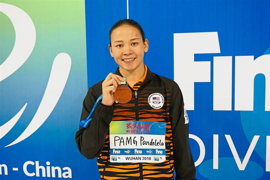 Pandelela Rinong made her way into the history books as Malaysia's first individual medallist at the FINA Diving World Cup in Wuhan, China, after a superb comeback in the women's 10m platform individual competition. She won the bronze