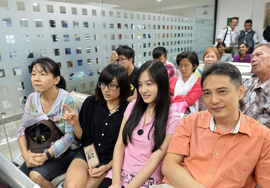 Jonathan and his family, Sabrina (in pink), Nicole (in black) and wife Kelly at the Immigration Department.