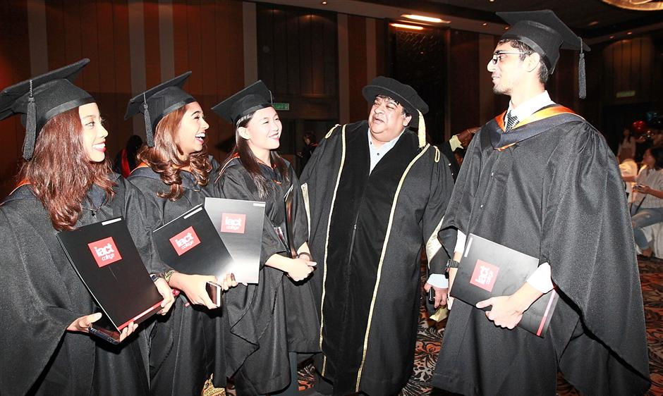 Raja Singham (second from right) chatting with graduates who received awards during the IACT Convocation 2018.