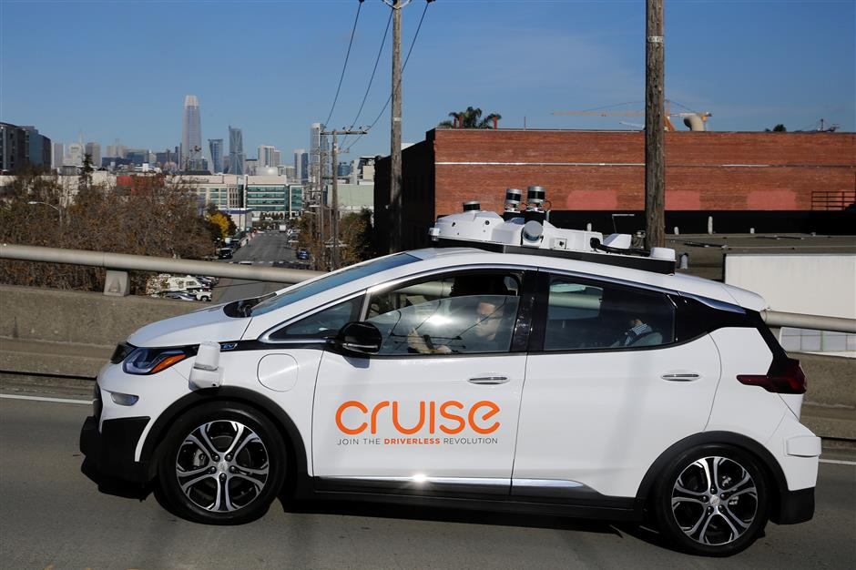 The San Francisco skyline is seen behind a self-driving GM Bolt EV during a media event where Cruise, GM's autonomous car unit, showed off its self-driving cars in San Francisco, California, U.S. November 28, 2017. REUTERS/Elijah Nouvelage