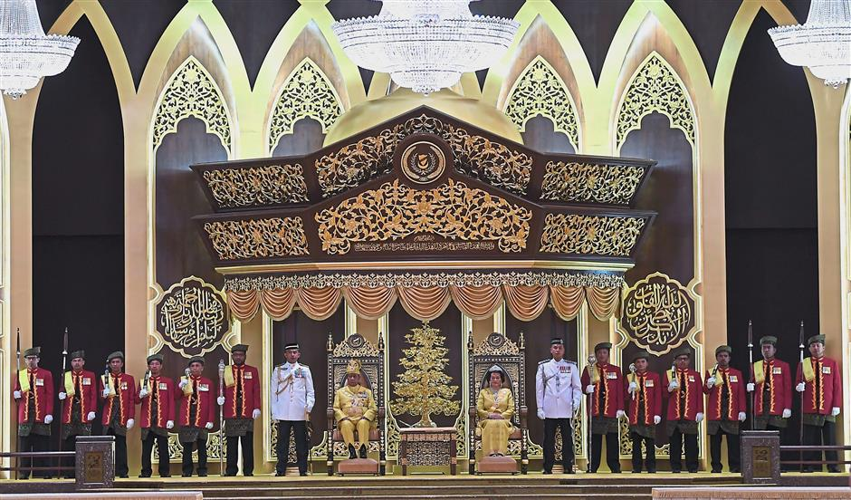 Royal affair: Sultan Sallehuddin and Sultanah Maliha sitting on the throne during the installation ceremony at the Balairung Seri at Istana Anak Bukit, Alor Setar. u2014 Bernama