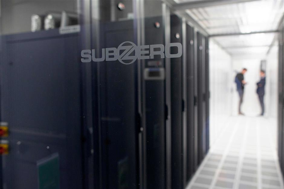 Server cabinets are kept in carefully controlled environments inside Servecentric Data Centre on the outskirts of Dublin in Ireland on December 10, 2018. - Fortunes are being made in clusters of anonymous warehouses outside Dublin that contain vast data centres driving the digital boom of a fourth industrial revolution. (Photo by PAUL FAITH / AFP)