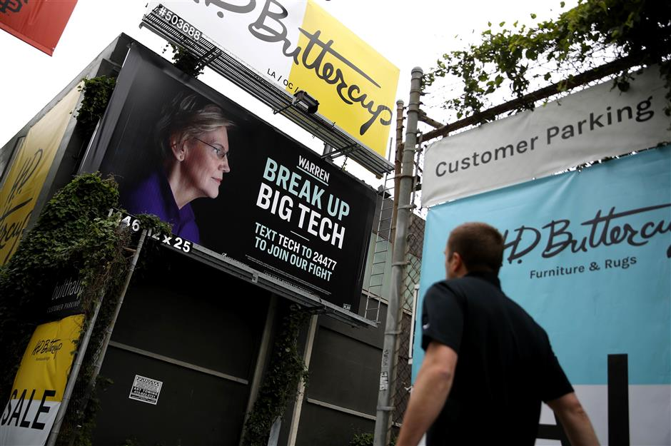 SAN FRANCISCO, CALIFORNIA - MAY 30: A billboard with an image of Democratic presidential hopeful U.S. Sen. Elizabeth Warren (D-MA) on May 30, 2019 in San Francisco, California. The presidential campaign for U.S. Sen. Elizabeth Warren posted a billboard in the South of Market Area of San Francisco that calls for breaking up big tech.   Justin Sullivan/Getty Images/AFP == FOR NEWSPAPERS, INTERNET, TELCOS & TELEVISION USE ONLY ==