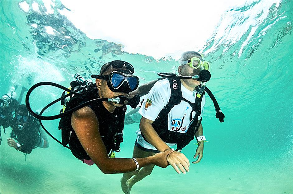 The certified dive instructors would accompany the disabled at all times during the dive